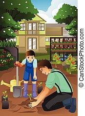 Father and son planting in the garden together