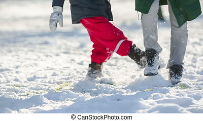 father and son play in snow