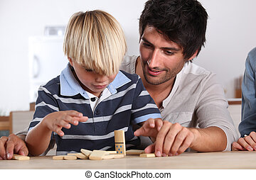 Father and son playing domino