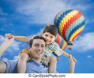 Father and Son Playing Piggyback with Hot Air Balloons ...