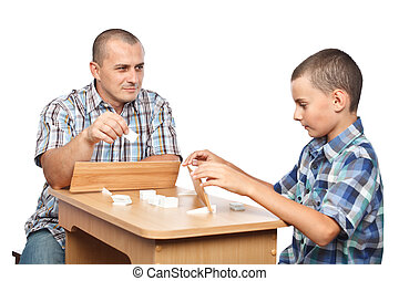 Father and son playing rummy, isolated on white background