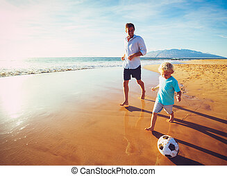 Father and Son Playing Soccer