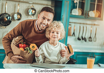 Father and son preparing dinner in the kitchen