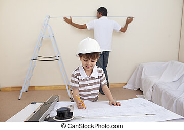 Father and son refurbishing home - Happy father and son...