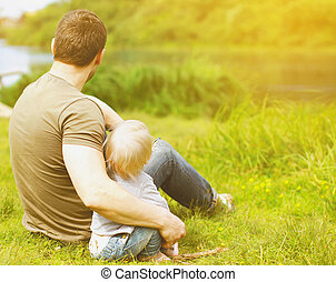 Father and son resting on the nature