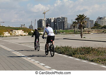 Father and son riding on bicycles