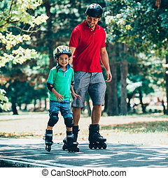 Father and son roller skating