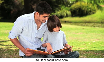 Father and son sitting reading