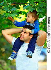 father and son spending time together outdoors