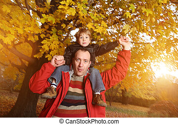 Father and son - Portrait of happy father giving son...
