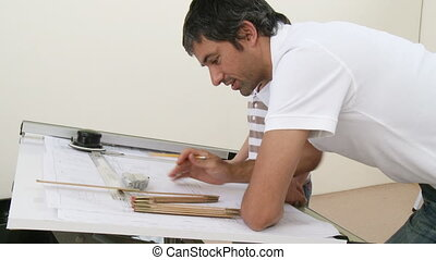 Father and son studying architecture at home