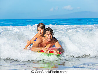 Father and Son Surfing Tandem Togehter Catching Ocean Wave, Carefree happy fun smiling lifestyle