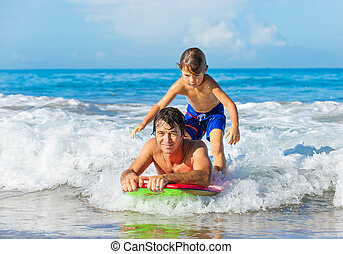 Father and Son Surfing Tandem Together Catching Ocean Wave,...