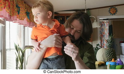 Father and son toddler stay at home in kitchen