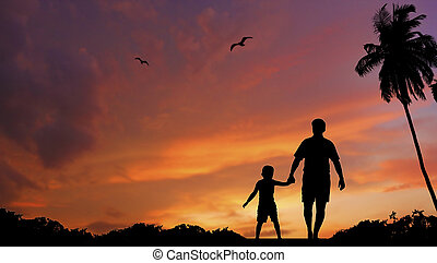 Father and son walking together - silhouette of father and...