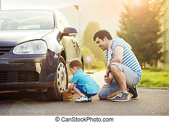 Father and son washing car - Young father with his little ...