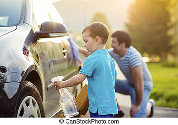 Father and son washing car - Young father with his little...