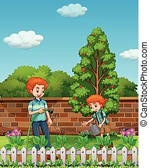 Father and son watering plants in the garden