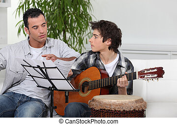 Father and son with a guitar