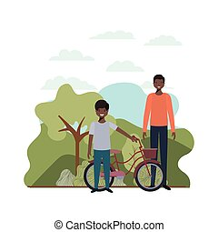 father and son with bicycle in landscape