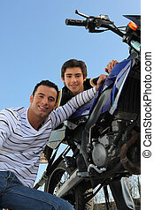 Father and son with motorcycle