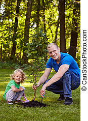 Father and son with tree