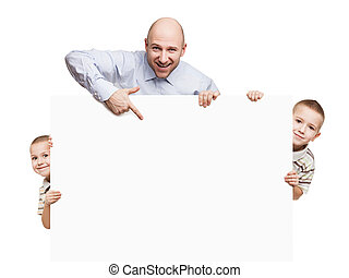 Father and sons holding blank sign or placard
