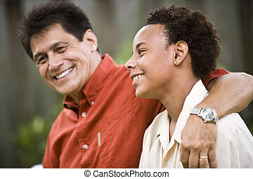 Father and teenage son - Hispanic father with African ...
