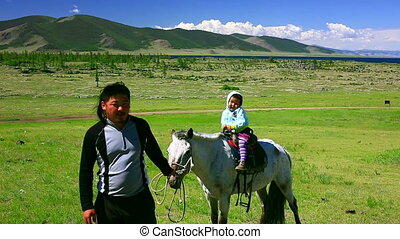 Father and young daughter in Mongolian landscape