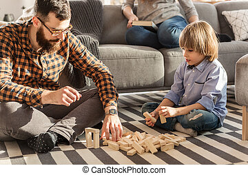 Father arranging bricks with son
