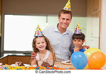 Father celebrating birthday with his kids
