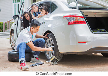 Father change tire