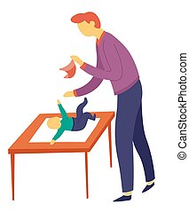 Father changing sons diaper on table child care and fatherhood