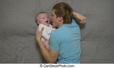 Father Cheers Baby Boy - Father cheers baby boy young man 30...