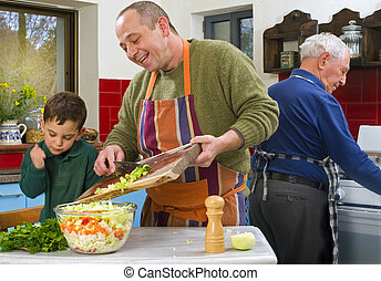 father child and grandfather cooking in the kitchen together