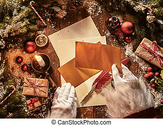Father Christmas writing a letter celebrating Xmas