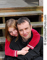 Father daughter - Portrait of a father and daughter on deck...