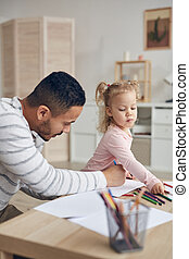 Father Drawing with Little Girl