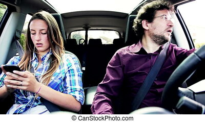 Father driving car angry with girl