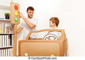 Father explaining traffic regulations to his kid - Dad...