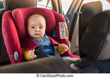 Father fasten his baby in car seat - Father fasten his...