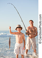 Father fishing with his son