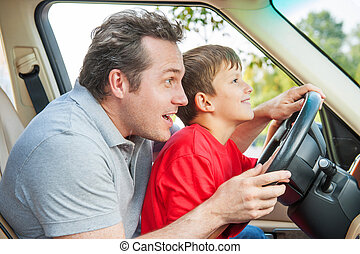 Father gives his son driver lessons, enjoying time together