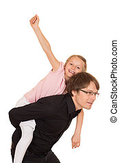 Father giving piggyback ride to his daughter