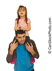 Father giving piggyback ride to his girl