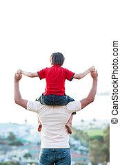 Father giving son piggyback ride outdoors
