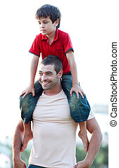 Father giving son piggyback ride