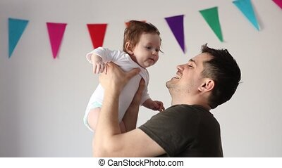 Father have a fun time with a child