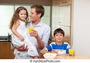 Father having breakfast with his kids