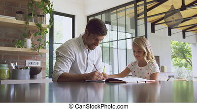 Father helping her daughter in homework at home 4k - Front ...